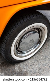 Minsk, Belarus, August 14 2018 - Orange Volkswagen Type 2 VW T2 chrome wheel parked on the street, known as the Transporter, Kombi or Microbus, or Bus Camper panel van introduced in 1950 by the German