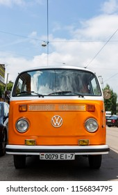 Minsk, Belarus, August 14 2018 - Orange and white Volkswagen Type 2 VW T2 parked on the street, known as the Transporter, Kombi or Microbus, or Bus Camper panel van introduced in 1950 by the German
