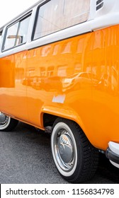 Minsk, Belarus, August 14 2018 - Orange Volkswagen Type 2 VW T2 parked on the street, known as the Transporter, Kombi or Microbus, or Bus Camper panel van introduced in 1950 by the German automaker