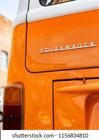 Minsk, Belarus, August 14 2018 - Orange Volkswagen Type 2 VW T2 logo parked on the street, known as the Transporter, Kombi or Microbus, or Bus Camper panel van introduced in 1950 by the German