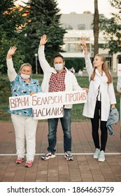 MINSK, BELARUS - AUGUST 14, 2020. Doctors have become a chain of solidarity. People are holding flowers, flags and posters. Minsk, Belarus. Protest against dictator Lukashenko