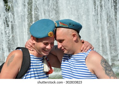 MINSK, BELARUS AUGUST 2, 2015: Unidentified paratroopers hugging near fountain during the celebration of the Paratroopers VDV Day on 2 August 2015 in Minsk.