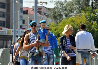 MINSK, BELARUS AUGUST 2, 2015: Unidentified family walking during the celebration of the Paratroopers VDV Day on 2 August 2015 in Minsk.