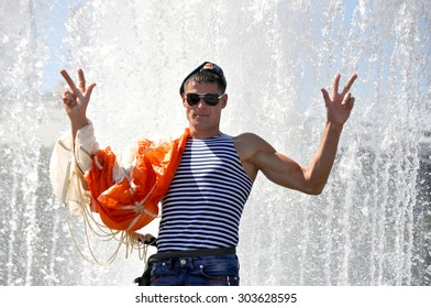 MINSK, BELARUS AUGUST 2, 2015: Unidentified paratrooper posing in fountain during the celebration of the Paratroopers VDV Day on 2 August 2015 in Minsk.