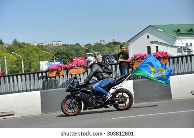 MINSK, BELARUS AUGUST 2, 2015: Unidentified paratrooper riding a bike during the celebration of the Paratroopers VDV Day on 2 August 2015 in Minsk.
