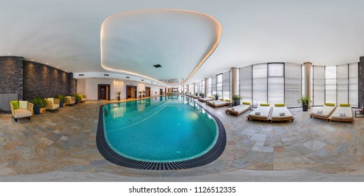 MINSK, BELARUS - AUGUST, 2017: Full seamless panorama 360 degrees angle view in interior of modern swimming pool in elite hotel in equirectangular spherical projection. VR content