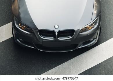 Minsk, Belarus - August 21, 2016: Car BMW Coupe E92 standing on asphalt road in city Minsk, Belarus at daytime