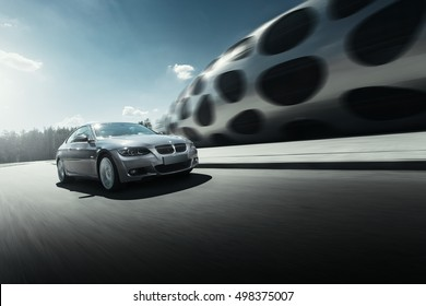 Minsk, Belarus - August 21, 2016: Car BMW Coupe E92 drive on asphalt road near modern building at daytime
