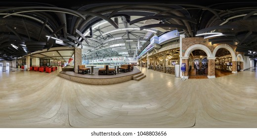 MINSK, BELARUS - AUGUST 26, 2014: panorama 360 angle view in modern trade center near food court with red chairs. Full 360 degrees seamless equirectangular spherical panorama. skybox vr ar content