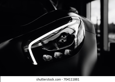 Minsk, Belarus - August 26, 2017: Headlight close-up of Mercedes Benz AMG GT 50 Edition sports car. A new 2017 supercar designed to celebrate the 50th anniversary of the AMG company