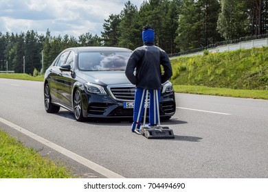 MINSK, BELARUS - AUGUST 27, 2017: Mercedes-Benz S-class (W222) demonstrates Active Brake Assist with Pedestrian Detection. Car automatically brakes in front of a dummy to prevent a collision.