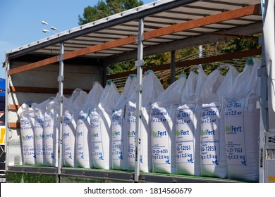 Minsk, Belarus - August 30 2020: Chemical fertilizers Commercial products are packaged in bags and loaded into a truck.