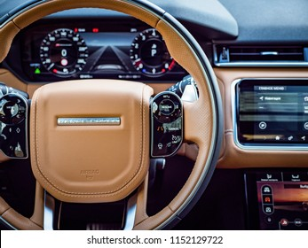 MINSK, BELARUS - AUGUST 7, 2018: Photo of Range Rover Velar's interior. Interior features caramel-browm leather trim on seats and dashboard. Range Rover Velar's cabin exudes elegant simplicity.