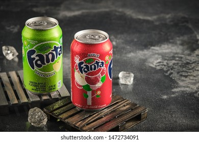 MINSK, BELARUS - AUGUST 7, 2019: Aluminium can of the Fanta Green Apple and Apple Fanta on grey background. Fanta non-alcoholic strongly carbonated soft drink; trademark owned by the Coca-Cola Company