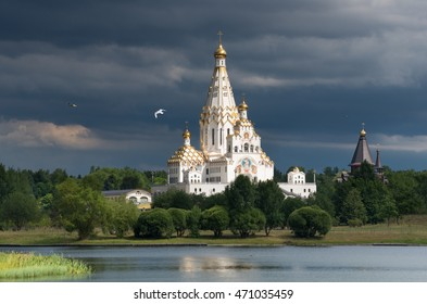 Minsk, Belarus. Cathedral Of All Saints In Minsk - The Biggest Orthodox Church Of Belarus.  Famous Landmark. Temple With Gold Domes Against The Background Of A Dark Stormy Sky, Scenic View