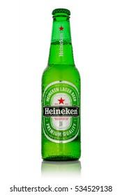 MINSK, BELARUS - DECEMBER 12, 2016: Bottle of Heineken Lager Beer on white background. Heineken Lager Beer is a pale lager beer produced by the Dutch brewing company Heineken International