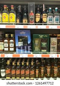 Minsk, Belarus - December 18, 2018: Alcohol bottles of various manufacturers on supermarket shelves
