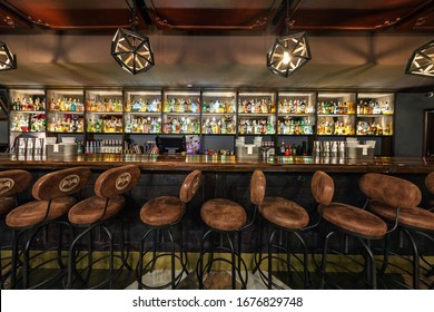 MINSK, BELARUS - DECEMBER, 2017: inside interior in modern pub restaurant with dark loft design style