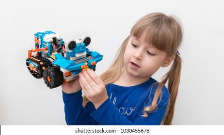 Minsk, Belarus. December, 2017. STEM education. Little girl shows and programmes Lego  Boost Robot.  Robotics class for child and teen. School.  Mathematics. Code the bot.