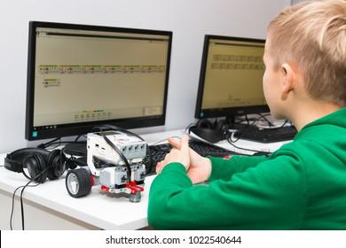 Minsk, Belarus. December, 2017. Teenager boy constructs and programmes Lego Robot Mindstorms EV3 at robotics school. Education of children and teenagers. Stem education.