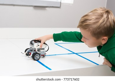 Minsk, Belarus. December, 2017. Teenager boy constructs and programmes Lego Robot Mindstorms EV3. Education of children and teenagers. Stem education. Competition.