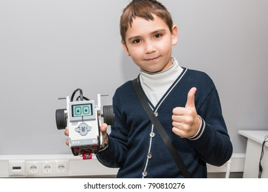 Minsk, Belarus. December, 2017. Teenager boy constructs and programmes Lego Robot Mindstorms EV3. Education of children and teenagers. Stem education. Competition.