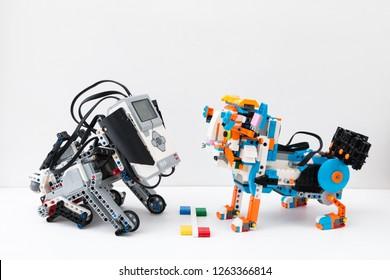 Minsk, Belarus. December, 2018. Dog robot Lego Mindstorms EV3 VS Cat robot lego Boost. Stem education, robotics, design, art, science, mathematics, chemistry. STEAM. DIY.