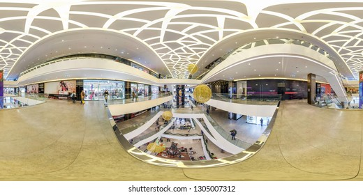 MINSK, BELARUS - DECEMBER, 2018: Full spherical seamless 360 panorama degrees angle view in interior of huge modern hall of multi-storey trade center mall in equirectangular projection, AR VR content