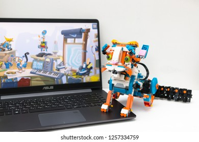 Minsk, Belarus. December, 2018. Lego Boost Robot Frankie The Cat is on the white background. Some gears are near it. The best robot for STEM and STEAM education. DIY. AI. Best toy for children.