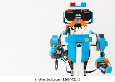 Minsk, Belarus. December, 2018. Robot policeman with handcuffs made of Lego Boost. Little robots. The best toy for children and teenagers. Programmable toy. STEM education. Like. White background. DIY