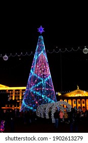 Minsk. Belarus. December 25, 2020. A view of the festive Christmas tree in the dark. Independence Avenue is decorated with bright lights for the winter holidays.