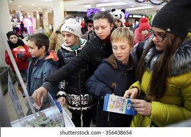 MINSK, BELARUS - DECEMBER 29, 2015: People donate money for the new building of Belarusian Children's Hospice