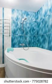 MINSK, BELARUS - DECEMBER 8, 2017: Interior of the modern bathroom in flat in light blue color style