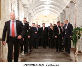 MINSK, BELARUS - Feb 11, 2015: President of Republic of Belarus Lukashenko, President of Ukraine Poroshenko and Chancellor of Federal Republic of Germany Merkel before a meeting of leaders of states