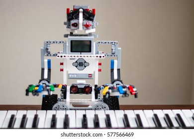 Minsk, Belarus -  February 11, 2017: Lego robot is playing the piano. Music. School Robotics. E-learning. Modern teaching technology. STEM education.