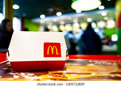 Minsk, Belarus, February 12, 2018: Big Mac Box with McDonald's logo on table in McDonald's Restaurant