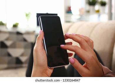 Minsk, Belarus - February 16, 2019 : Woman holding smartphone samsung galaxy s8 in hand Illustrative editorial
