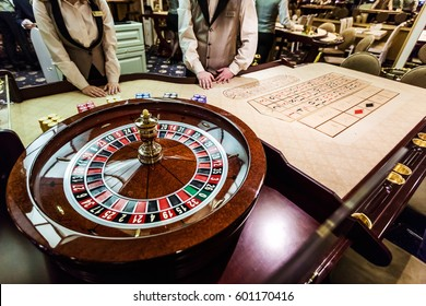 MINSK, BELARUS - FEBRUARY 2, 2017: gambling chips and cards on a game table roulette