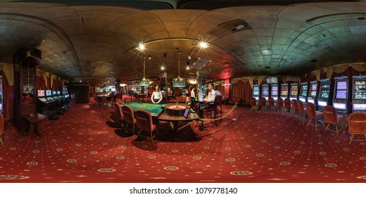 MINSK, BELARUS - FEBRUARY, 2017: full seamless panorama 360 degrees angle view in interior elite luxury casino with croupiers girls in red style in equirectangular spherical projection. VR content