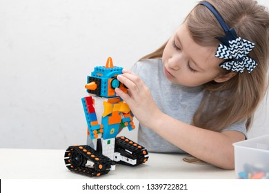 Minsk, Belarus. February, 2019. STEM and STEAM education. Cute little girl code robot in the class of engineering and chemistry on Scratch. Lego Boost. Modern technologies. Robotics.