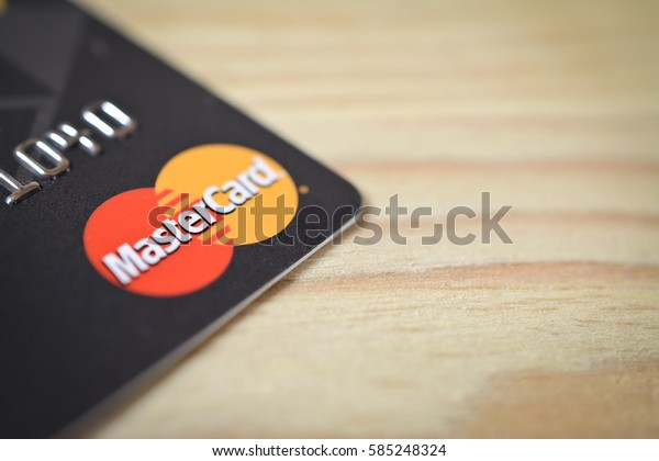 MINSK, BELARUS - February 22, 2017. Credit card with MasterCard logo on the table. MasterCard is an American multinational financial services corporation headquartered in New York, United States