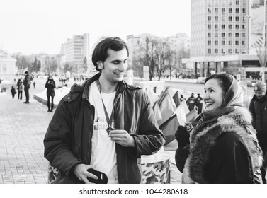 Minsk, Belarus. February 23, 2018 Promotion of a healthy lifestyle 'Running real men' Man and woman with medals stand outdoors