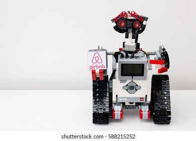 Minsk, Belarus -  February 26, 2017: Lego robot is holding a cube with the logo of the world's most famous booking site Airbnb. School. E-learning.  STEM education.