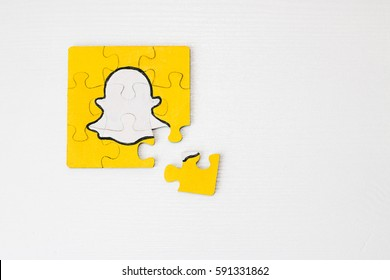 Minsk, Belarus - February 26, 2017:  Snapchat logo on puzzle. Social network. Handmade. Acril painted.