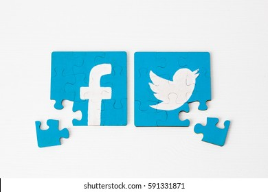 Minsk, Belarus - February 26, 2017: Facebook and Twitter logo on puzzle. Social network.   Handmade. Acril painted.