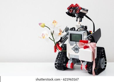 Minsk, Belarus -  February 26, 2017: Lego robot has prepared a gift - the Pandora jewelery box. Gold and silver jewelry. Best gift for Valentines Day and Mothers day. 8 march. Engagement and wedding.