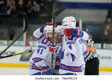 Minsk, Belarus - FEBRUARY 29, 2017: PATRICK THORESEN (41) forward of SKA(L), YEGOR YAKOVLEV (44) defensemen of SKA(C) and JARNO KOSKIRANTA (4) forward of SKA celebrates during the game