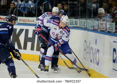 Minsk, Belarus - FEBRUARY 29, 2017: SERGEI PLOTNIKOV (16) forward of SKA battle for the puck during the game between Dinamo-Minsk and SKA at the Minsk-Arena in Minsk