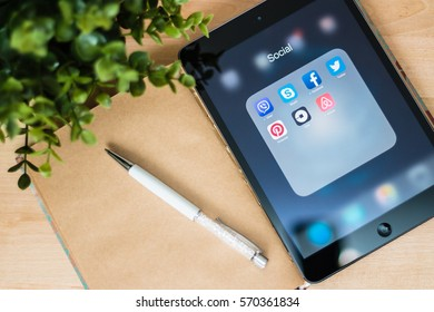 Minsk, Belarus - February 3, 2017:  Apple iPad is on the table with a tab open social networks: Facebook, Twitter, Vayber, Skype. Facebook, Pinterest, Uber, Airbnb logoes on the dice.