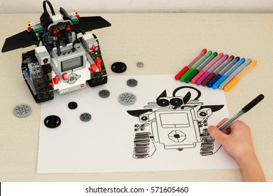 Minsk, Belarus -  February 4, 2017: Teenager schoolboy draws the Lego Robot.  School Robotics. Modern training. Gadgets. E-learning. Modern teaching technology. STEM education.